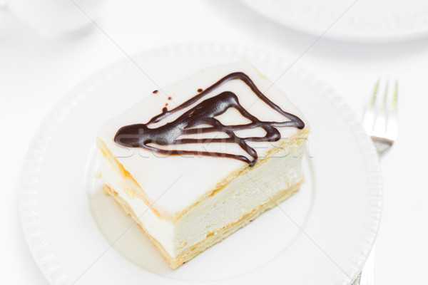 Room taart witte plaat chocolade Stockfoto © rafalstachura