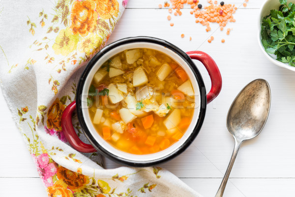 Top view of vegetable soup with red lentil on white wooden backg Stock photo © rafalstachura
