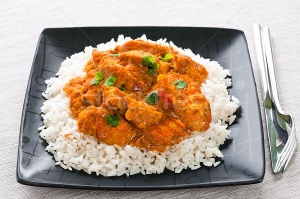 Caril de frango arroz preto prato faca garfo Foto stock © rafalstachura