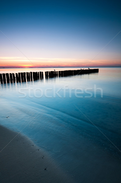 Stock photo: Breakwater Sunset
