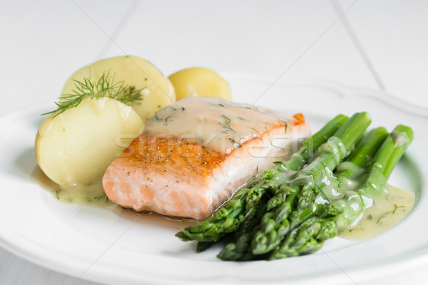 Grilled salmon with boiled potatoes and asparagus on white plate Stock photo © rafalstachura