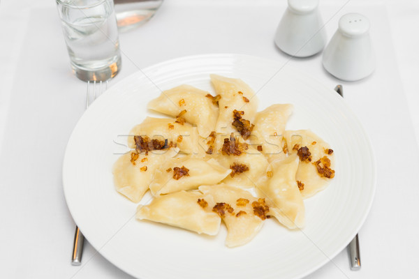 Russian dumplings with fried onion on white plate Stock photo © rafalstachura