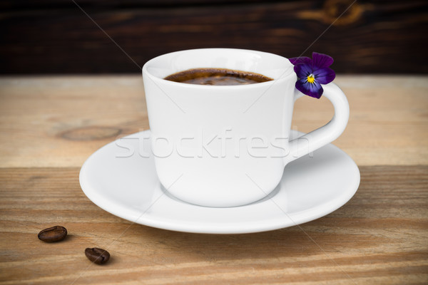 Cup of espresso with coffee beans on wooden table Stock photo © rafalstachura