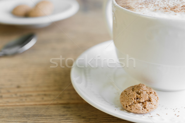 Cup of cafe latte with biscotti on wooden table Stock photo © rafalstachura
