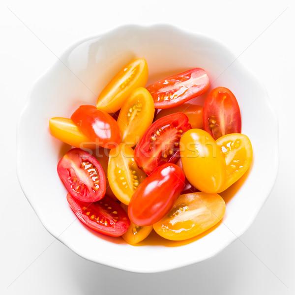 Tomates cerises blanche bol rouge jaune fond Photo stock © rafalstachura