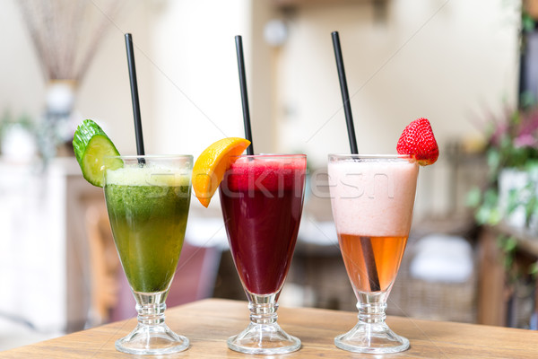 Assorted three fresh smoothies on wooden table Stock photo © rafalstachura