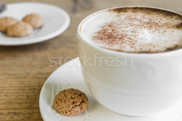 Cup of latte macchiato with biscotti on wooden table Stock photo © rafalstachura