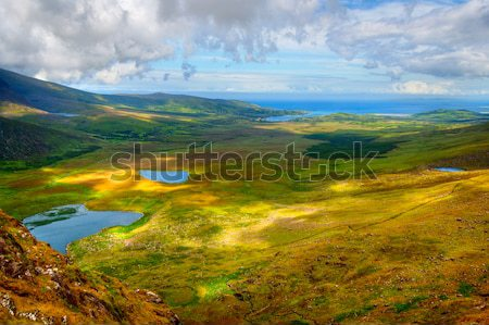 Península ensolarado montanha lago paisagem Foto stock © rafalstachura
