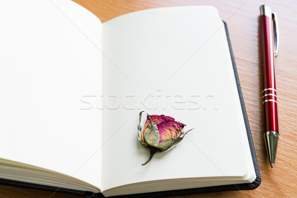Open Notebook With Dry Rose On Wooden Table With Copy Space Stock photo © rafalstachura