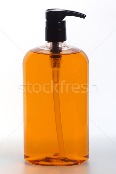 Genel pompa şişe turuncu sıvı ürün Stok fotoğraf © ralanscott