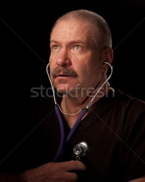 Adam karanlık bakım stetoskop kavram doktor Stok fotoğraf © ralanscott
