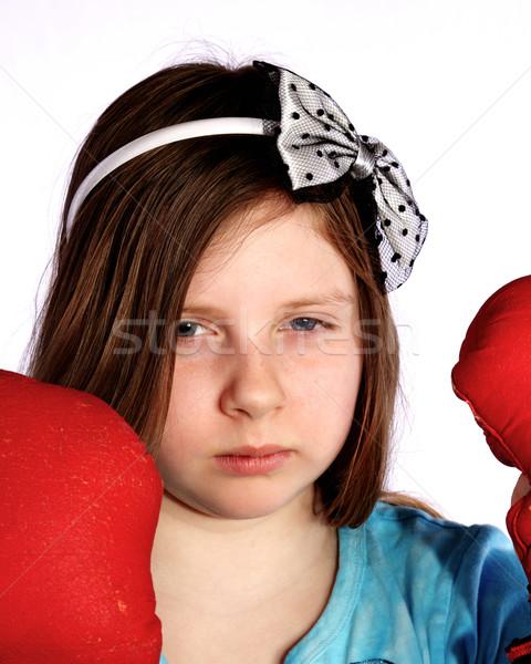 Jeune fille gants de boxe jeu visage fille Photo stock © ralanscott