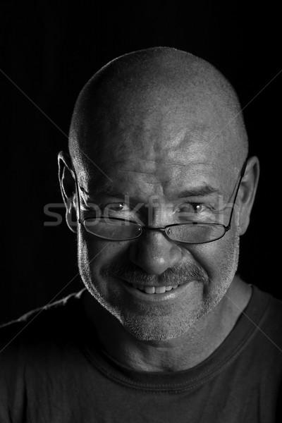 Kel adam gözlük siyah beyaz kafa atış Stok fotoğraf © ralanscott