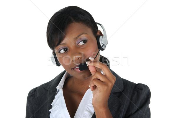 çekici iş kadını kulaklık yalıtılmış katı Stok fotoğraf © RandallReedPhoto