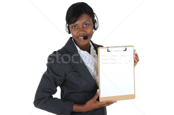 Atraente mulher de negócios fone clipboard isolado Foto stock © RandallReedPhoto