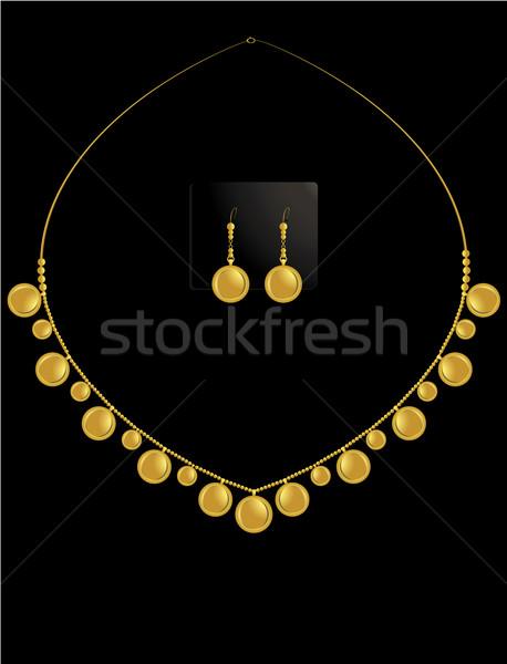 Zecchino collana set accoppiamento orecchini oro Foto d'archivio © randomway