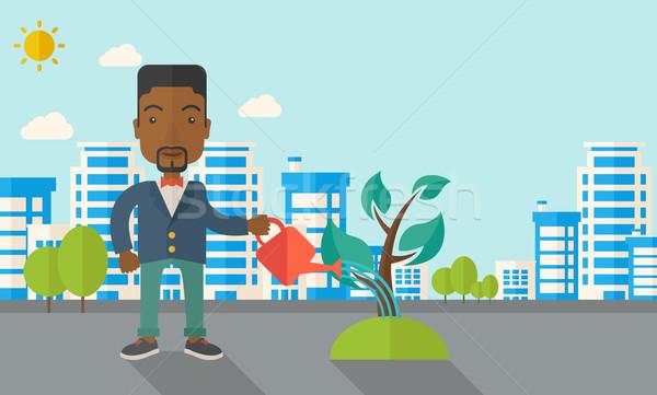 Fekete fickó locsol növény növekvő gazdaság Stock fotó © RAStudio