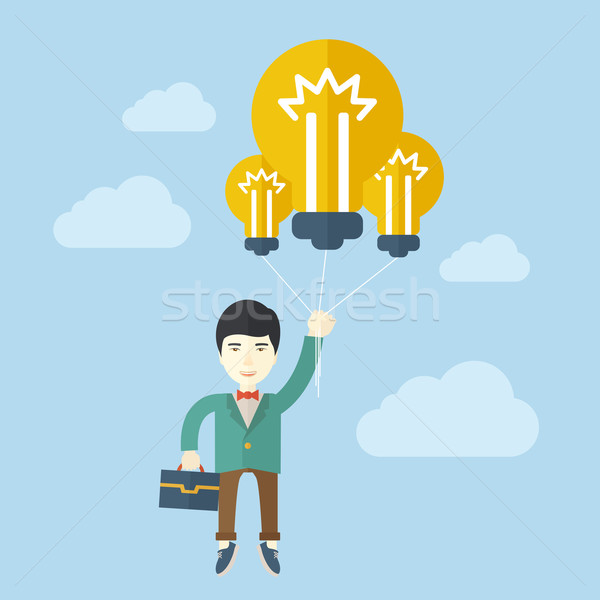 Asian businessman carrying a briefcase with bulb. Stock photo © RAStudio