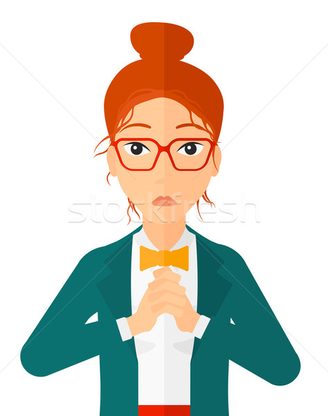Regretful woman with clasped hands. Stock photo © RAStudio