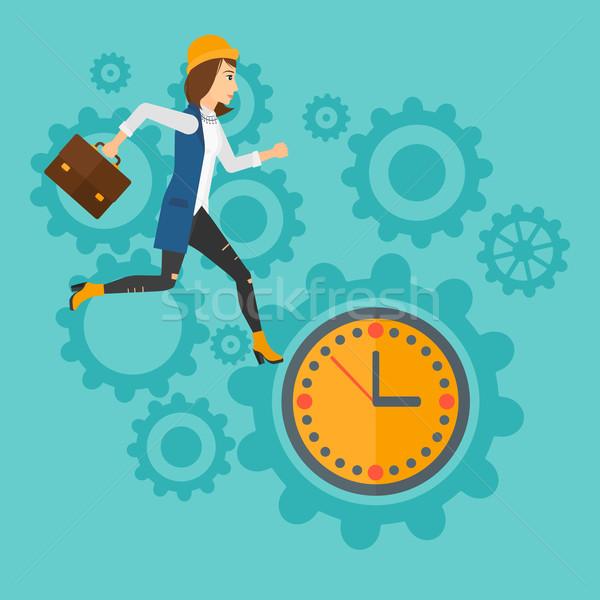 Running woman on clock background. Stock photo © RAStudio