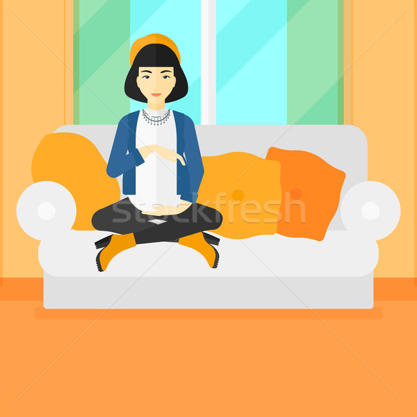 Pregnant woman sitting on sofa. Stock photo © RAStudio
