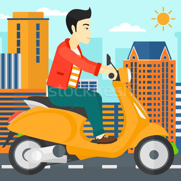 Man riding scooter. Stock photo © RAStudio