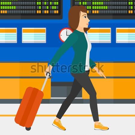 Mulher caminhada mala asiático programar conselho Foto stock © RAStudio