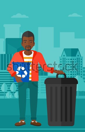 Man with recycle bins. Stock photo © RAStudio
