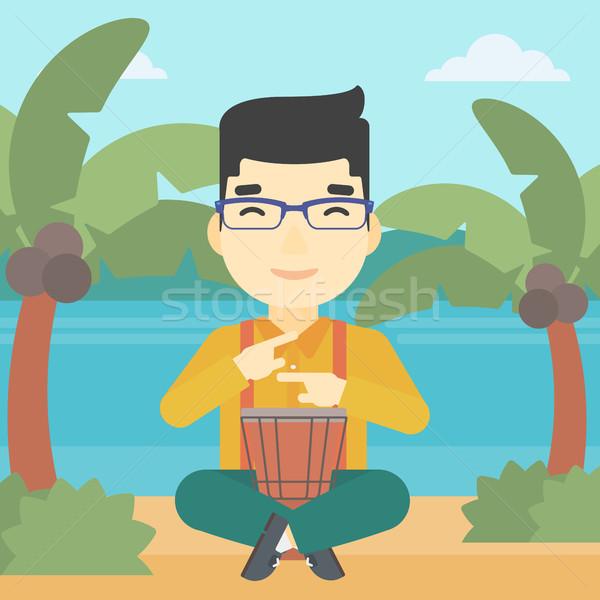 Man playing ethnic drum vector illustration. Stock photo © RAStudio