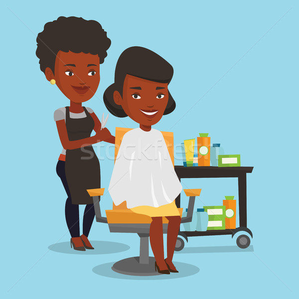 Hairdresser making haircut to young woman. Stock photo © RAStudio