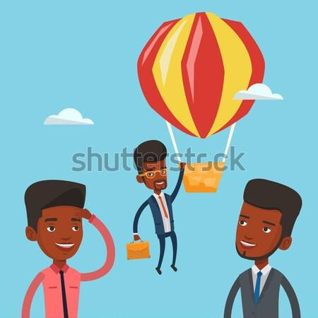 Business woman hanging on balloon. Stock photo © RAStudio