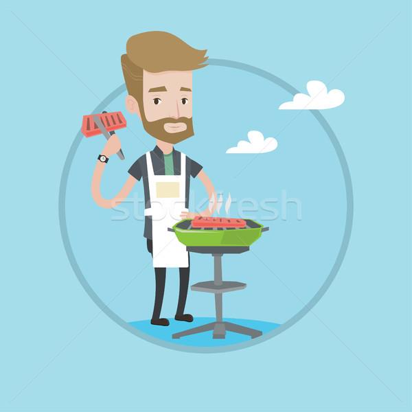 Férfi főzés steak barbecue grill hipszter hús Stock fotó © RAStudio