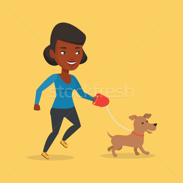 Young woman walking with her dog. Stock photo © RAStudio