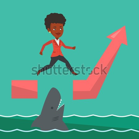 Business woman jumping over ocean with shark. Stock photo © RAStudio
