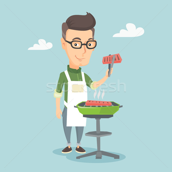 Férfi főzés steak barbecue grill kaukázusi derűs Stock fotó © RAStudio