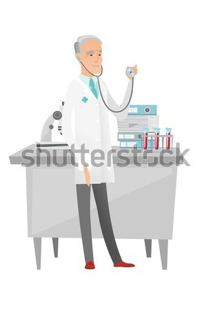 Souriant médecin stéthoscope jeunes main Photo stock © RAStudio