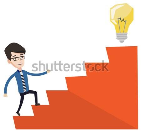 деловой человек ходьбе наверх Идея лампа азиатских Сток-фото © RAStudio
