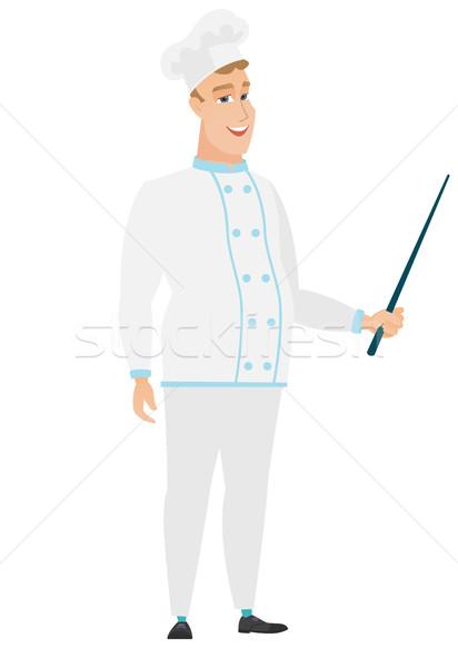 Caucasian chef cook holding pointer stick. Stock photo © RAStudio