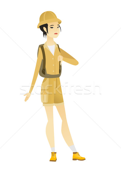 Disappointed asian traveler with thumb down. Stock photo © RAStudio