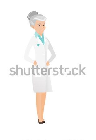 Senior caucasian doctor holding a money bag. Stock photo © RAStudio