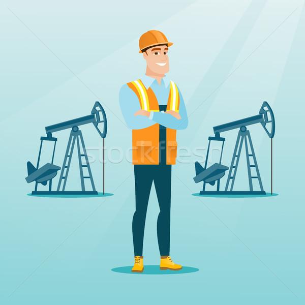 Zdjęcia stock: Pracownik · olej · uniform · kask · stałego · broni