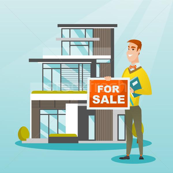 Jovem caucasiano corretor oferta casa alegre Foto stock © RAStudio