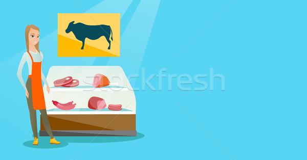 Slager aanbieden vers vlees winkel jonge Stockfoto © RAStudio
