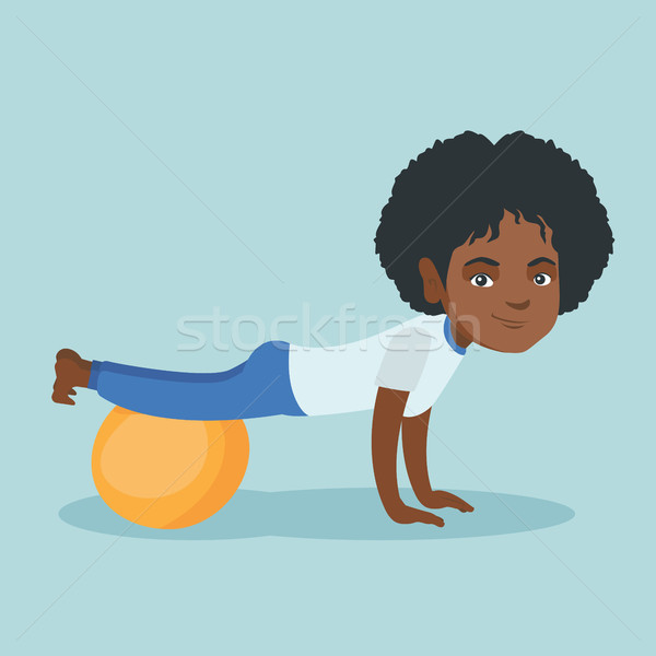 Young african woman exercising with fitball. Stock photo © RAStudio