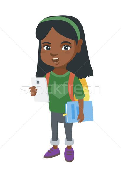 африканских школьница учебник улыбаясь Сток-фото © RAStudio