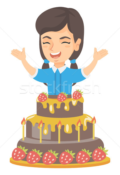 Little caucasian girl jumping out of a large cake. Stock photo © RAStudio