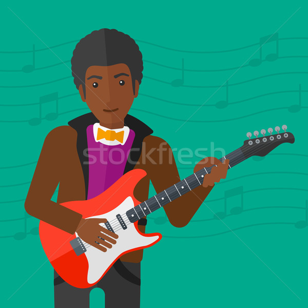 Musician playing electric guitar. Stock photo © RAStudio