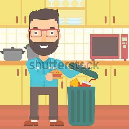 Człowiek kosza kuchnia Zdjęcia stock © RAStudio