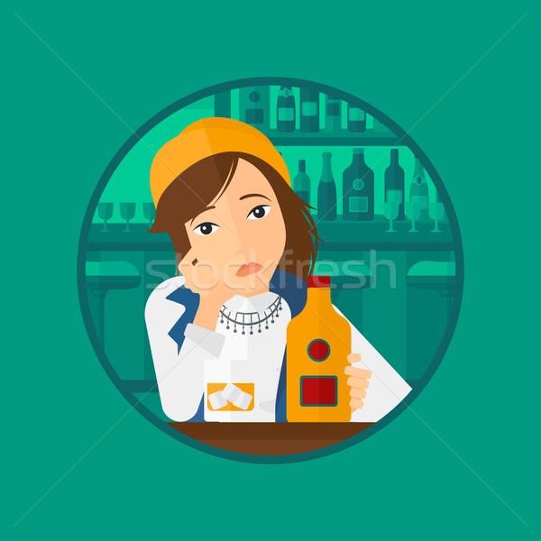 Sad woman drinking alcohol. Stock photo © RAStudio