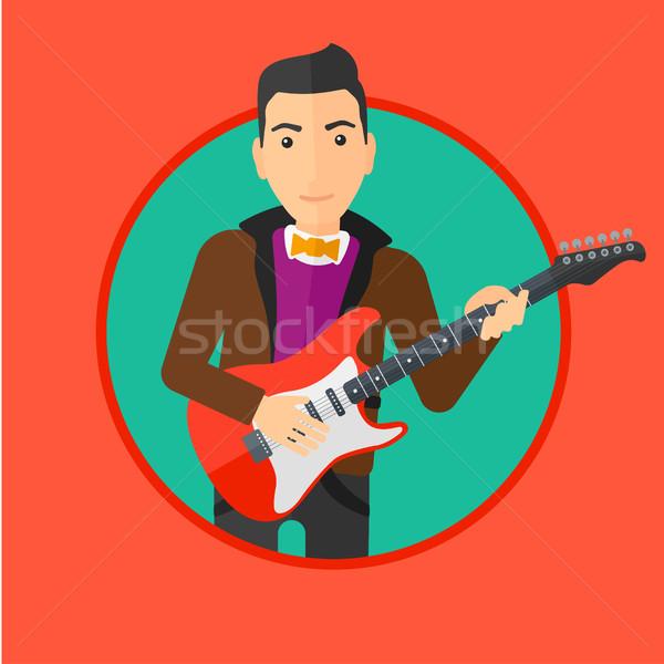 музыканта играет электрической гитаре молодые человека Сток-фото © RAStudio